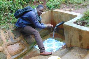 The Water Project: Musutsu Community, Mwashi Spring -  Field Officer Samuel Samidi At The Spring