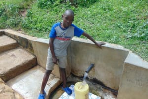 The Water Project: Isembe Community, Amwayi Spring -  Silas Okumu Fetches Water