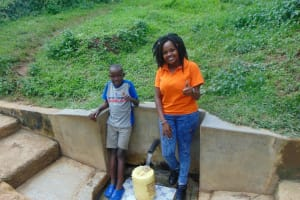 The Water Project: Isembe Community, Amwayi Spring -  Silas Okumu With Field Officer Georgina Kamau