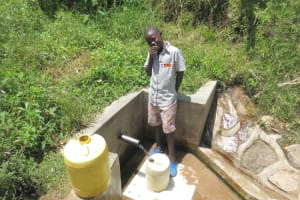 The Water Project: Emasera Community, Visenda Spring -  Joseph Musiomi Fetches Water