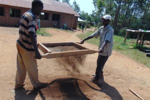 The Water Project: Lwanga Itulubini Primary School -  Sifting Sand For Construction