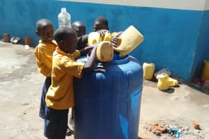 The Water Project: Friends Primary School Givogi -  Pupils Delivering Water For Construction
