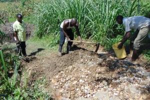 The Water Project: Shihungu Community, Shihungu Spring -  Mixing Concrete