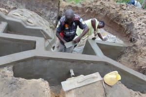 The Water Project: Ikonyero Community, Amkongo Spring -  Adding Plaster