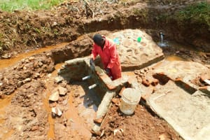 The Water Project: Lutonyi Community, Lutomia Spring -  Pipe Setting