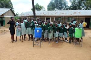 The Water Project: Lwanga Itulubini Primary School -  Training Complete Posing With Handwashing Stations