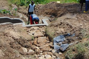 The Water Project: Sasala Community, Kasit Spring -  Stones In Place For Backfilling