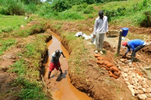 The Water Project: Lutonyi Community, Lutomia Spring -  Opening The Drainage Channels