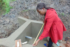 The Water Project: Buyangu Community, Osundwa Spring -  Field Officer Christine Masinde Supervising Works