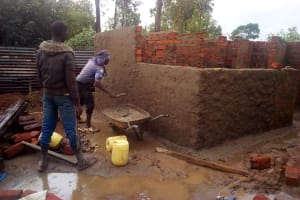 The Water Project: Friends Primary School Givogi -  Cementing The Latrine Walls