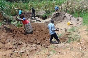 The Water Project: Shihungu Community, Shihungu Spring -  Soil Backfilling