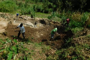 The Water Project: Ikonyero Community, Amkongo Spring -  Backfilling With Soil