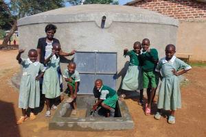 The Water Project: Lwanga Itulubini Primary School -  Celebrating The Rain Tank