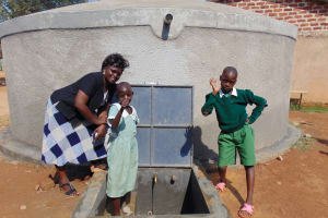 The Water Project: Lwanga Itulubini Primary School -  School Staff And Students At The Tank