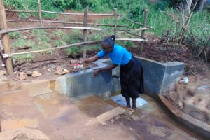 The Water Project: Lutonyi Community, Lutomia Spring -  Trainer Demonstrates Proper Cleaning Method