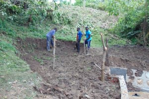 The Water Project: Buyangu Community, Osundwa Spring -  Backfilling With Soil And Fencing