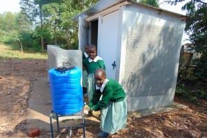 The Water Project: Lwanga Itulubini Primary School -  Handwashing Outside The Latrines