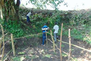 The Water Project: Buyangu Community, Osundwa Spring -  Digging The Cut Off Drainage Above The Spring