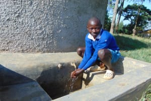 The Water Project: Sabane Primary School -  Student At Rain Tank