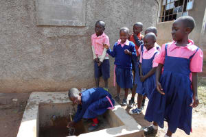 The Water Project: Friends Kaimosi Demonstration Primary School -  Students Fetching Water