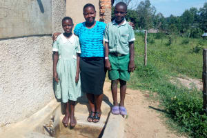 The Water Project: St. Joseph Eshirumba Primary School -  Field Officer Betty Majani With Students At The Tank