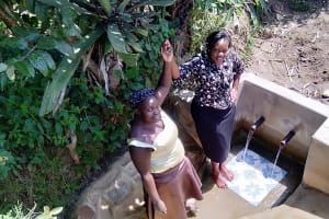 The Water Project: Matsakha Community, Mbakaya Spring -  Medline And Field Officer Karen Maruti Join Hands