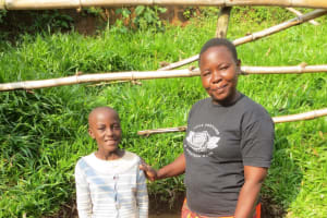 The Water Project: Handidi Community, Chisembe Spring -  Michelle Mushila With Field Officer Betty Muhongo