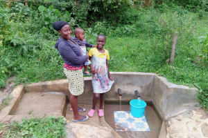 The Water Project: Luvambo Community, Timona Spring -  Mercy Anyango With Her Baby And Tabitha