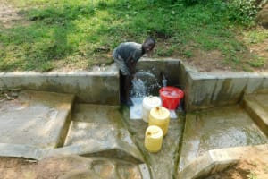 The Water Project: Chegulo Community, Yeni Spring -  Young Boy At The Spring