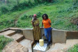 The Water Project: Isembe Community, Amwayi Spring -  Josephine Ambani With Field Officer Georgina Kamau