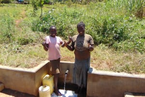 The Water Project: Shirugu Community, Jeremiah Mashele Spring -  All Smiles With Precious And Maureen Khavetsa