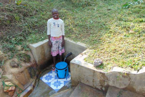The Water Project: Ematetie Community, Weku Spring -  Melvin Achitsa At The Spring