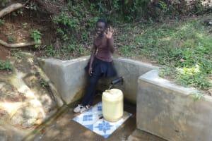 The Water Project: Shitirira Community, Peninah Spring -  Babra Kati Waves Hello From The Spring