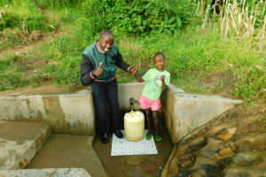 The Water Project: Elutali Community, Obati Spring -  Field Officer Jonathan Mutai And Ivine Muchema