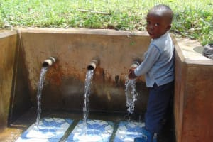 The Water Project: Irumbi Community, Shatsala Spring -  Young Boy At The Spring