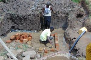 The Water Project: Shihungu Community, Shihungu Spring -  Brick Setting