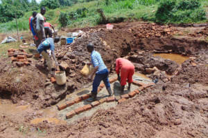 The Water Project: Lutonyi Community, Lutomia Spring -  Brick Setting With Teamwork
