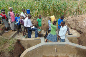 The Water Project: Shihungu Community, Shihungu Spring -  Taking Notes Fetching Water Demonstration