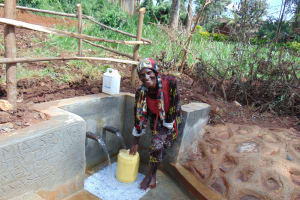 The Water Project: Lutonyi Community, Lutomia Spring -  Happy Filling Up