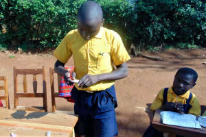 The Water Project: Friends Primary School Givogi -  Brian Mwangu Student Health Club Leader Demonstrates Toothbrushing