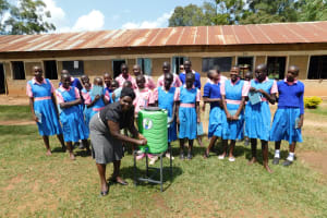 The Water Project: Kimangeti Primary School -  Students Giggle As A School Administrator Uses The Handwashing Station