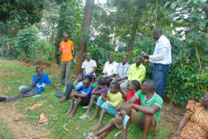 The Water Project: Shihungu Community, Shihungu Spring -  Community Member Leads A Discussion