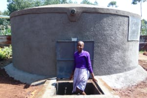 The Water Project: Magaka Primary School -  Student With Rain Tank