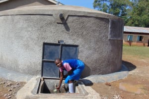 The Water Project: Kimangeti Primary School -  Getting A Drink From The Tank