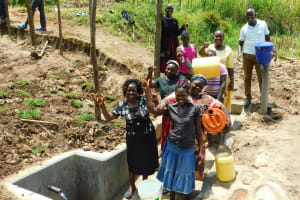 The Water Project: Ikonyero Community, Amkongo Spring -  At The New Spring To Fetch Water