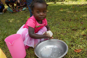 The Water Project: Buyangu Community, Osundwa Spring -  A Kid Hand Washing