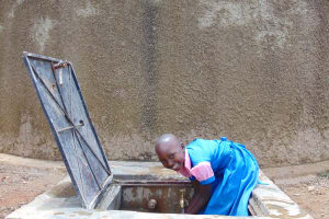 The Water Project: Kapsotik Primary School -  Sheila At The Rain Tanks Tap