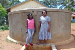 The Water Project: Lugango Primary School -  Field Officer Laura Alulu With Mrs Mideva