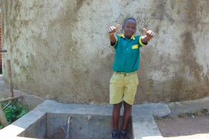 The Water Project: Muyere Primary School -  Student At The Rain Tank