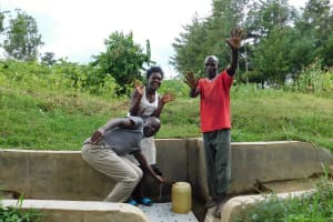 The Water Project: Shibuli Community, Khamala Spring -  Field Officer Victor Musemi With Yvonne And Jeremiah